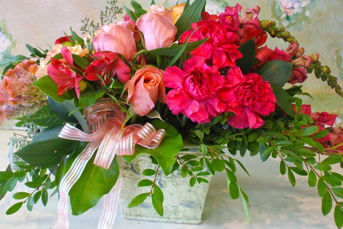 Bouquet of pink Carnations and Sweetheart Roses.